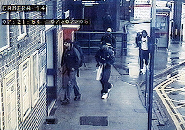 LondonFAKEDvideo-see left arm of man with white hat.jpg